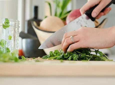 chopping cilantro with a knive